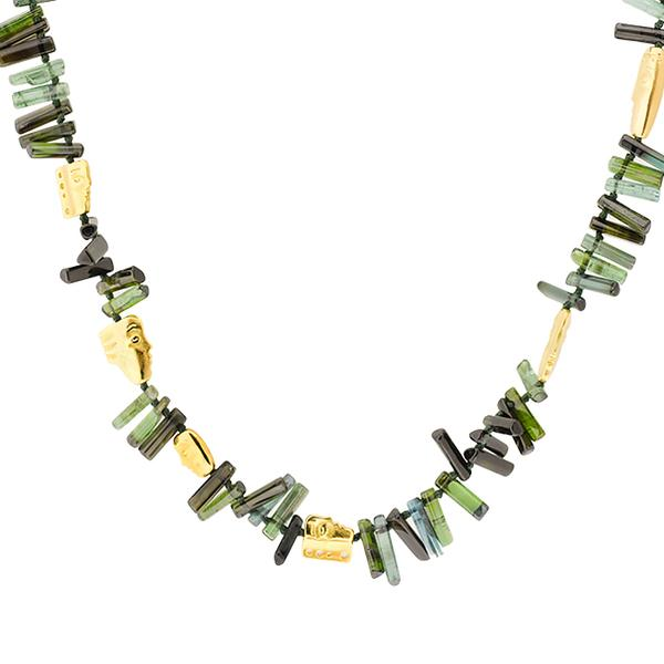 18KT. GREEN TOURMALINE  ELONGATED BEADS STRUNG WITH CARVED FACES